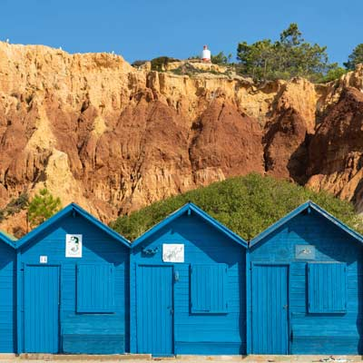 Fisherman's huts line the beach of Olhos de Agua